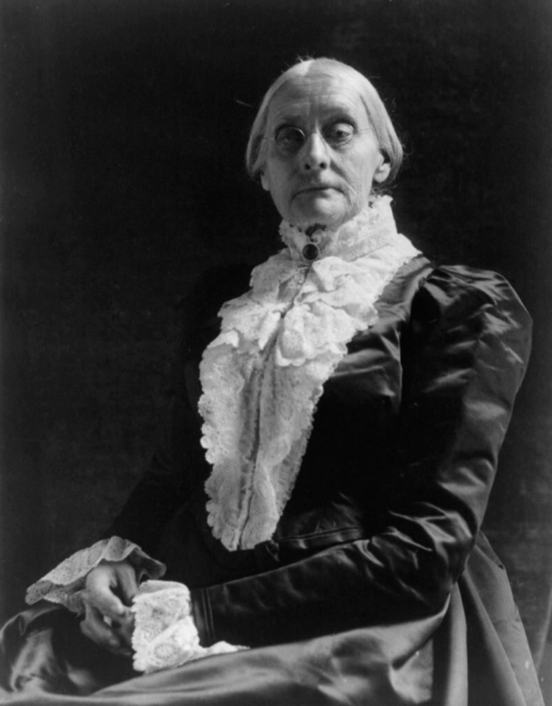 Susan B. Anthony, an older white woman in Victorian clothes, poses for a portrait.