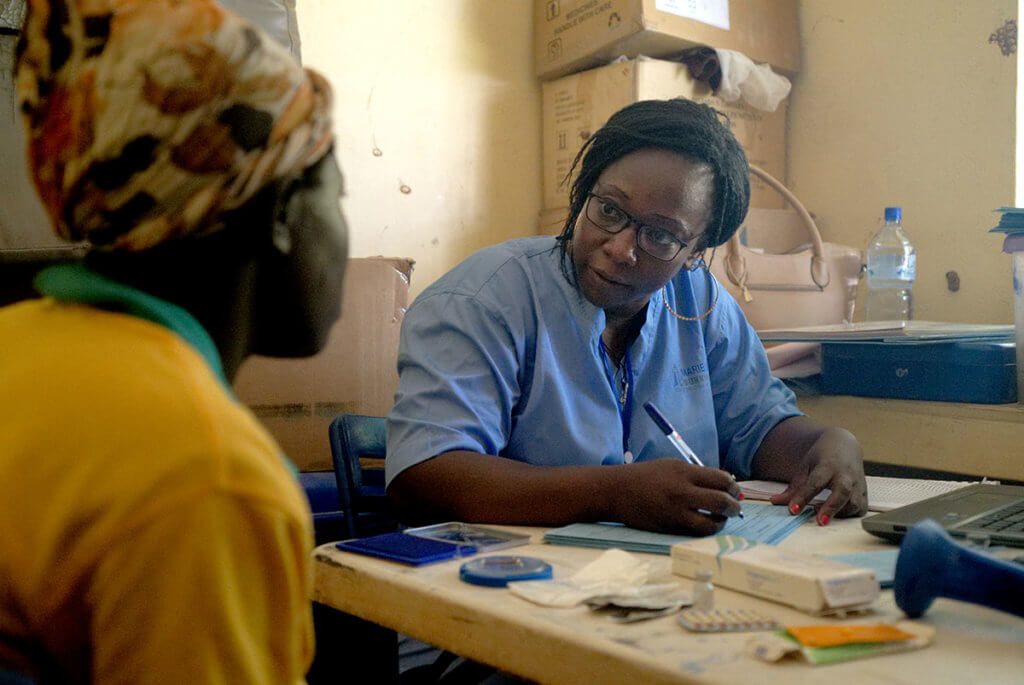 An MSI midwife provides reproductive healthcare to a woman in Burkina Faso.